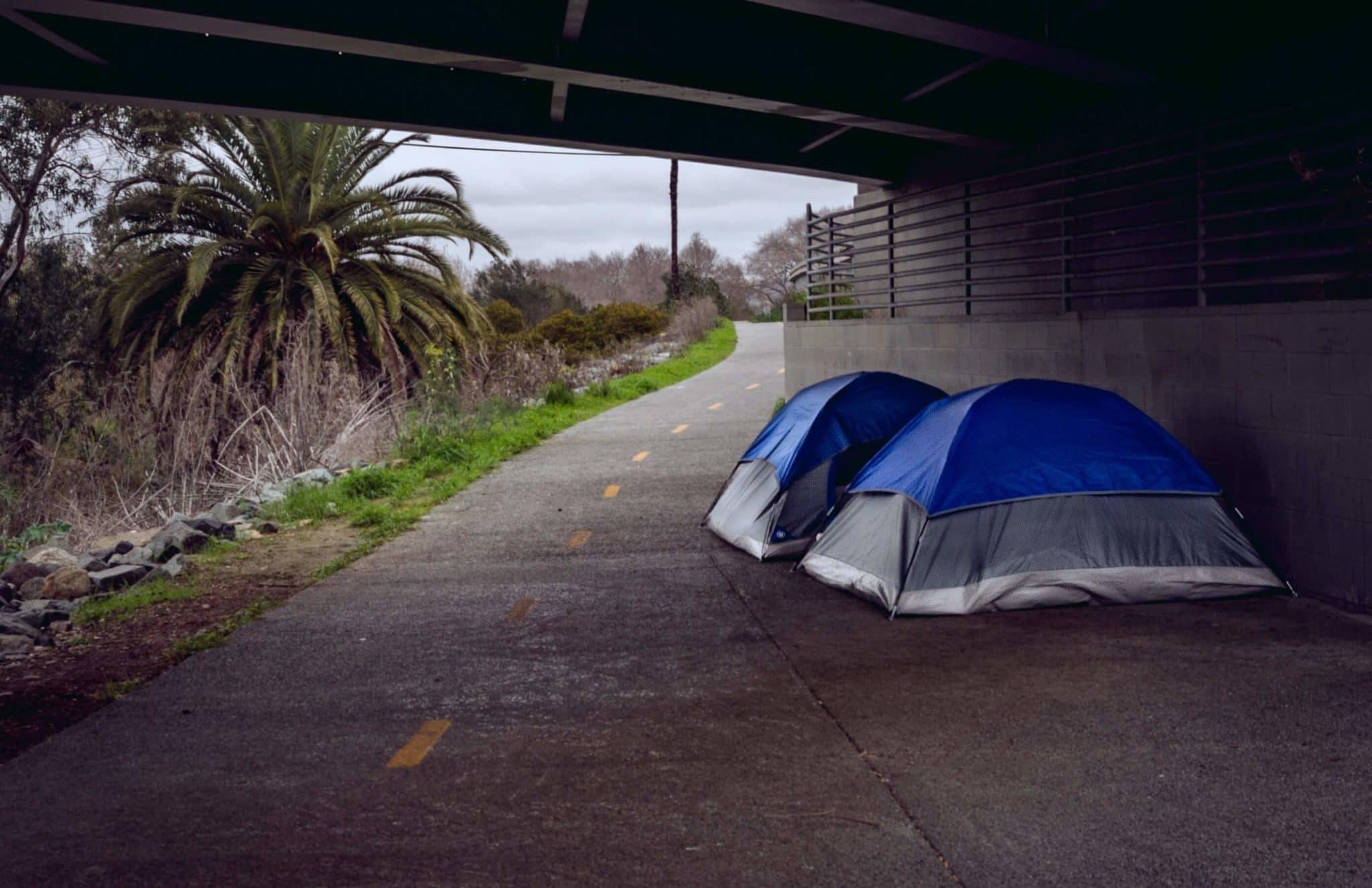 Tents of homeless people under bridge