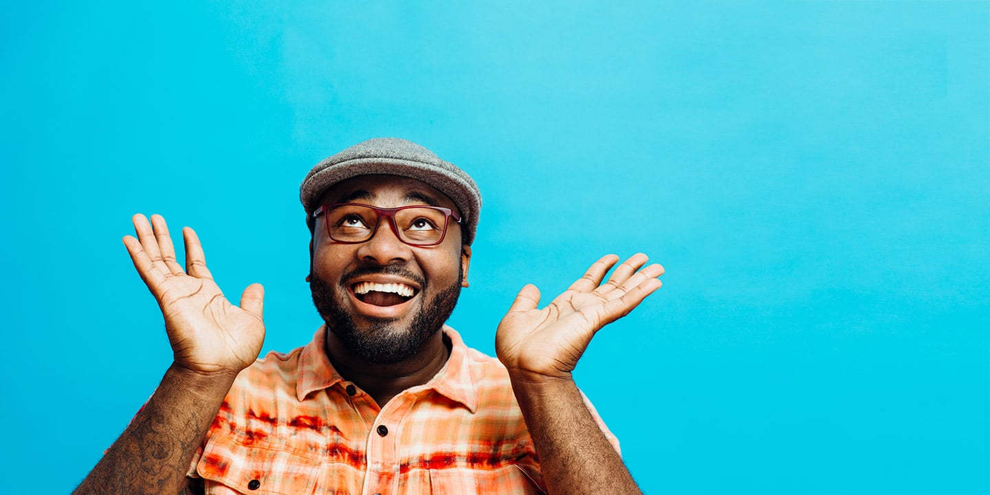 Man laughing with blue background