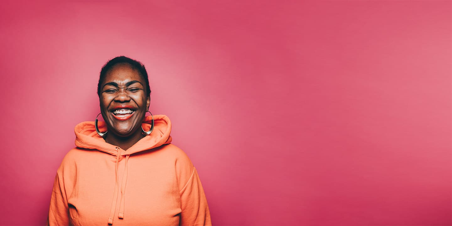 Woman laughing with red background