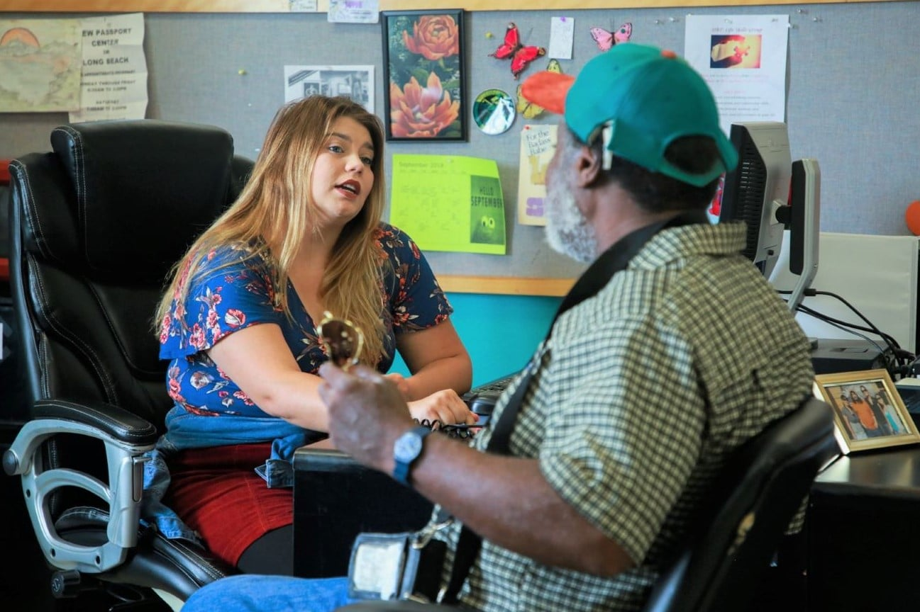 Staff member Alisha talking to a man