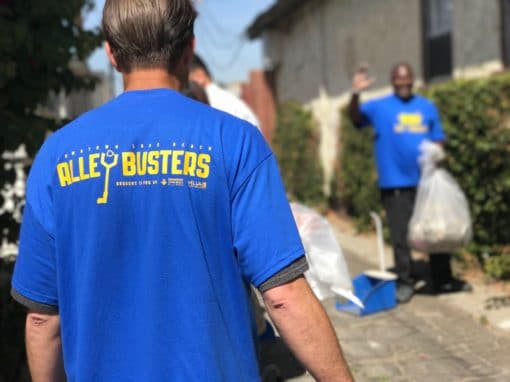 Man with back turned wearing AlleyBusters shirt
