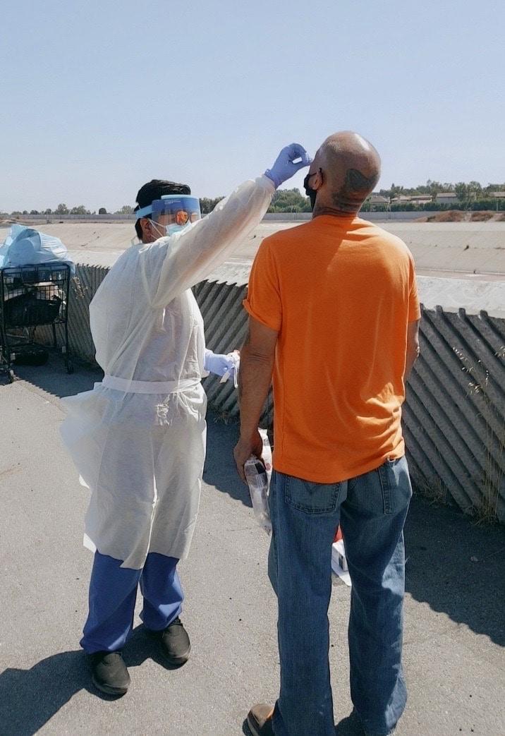 Health worker testing man on street