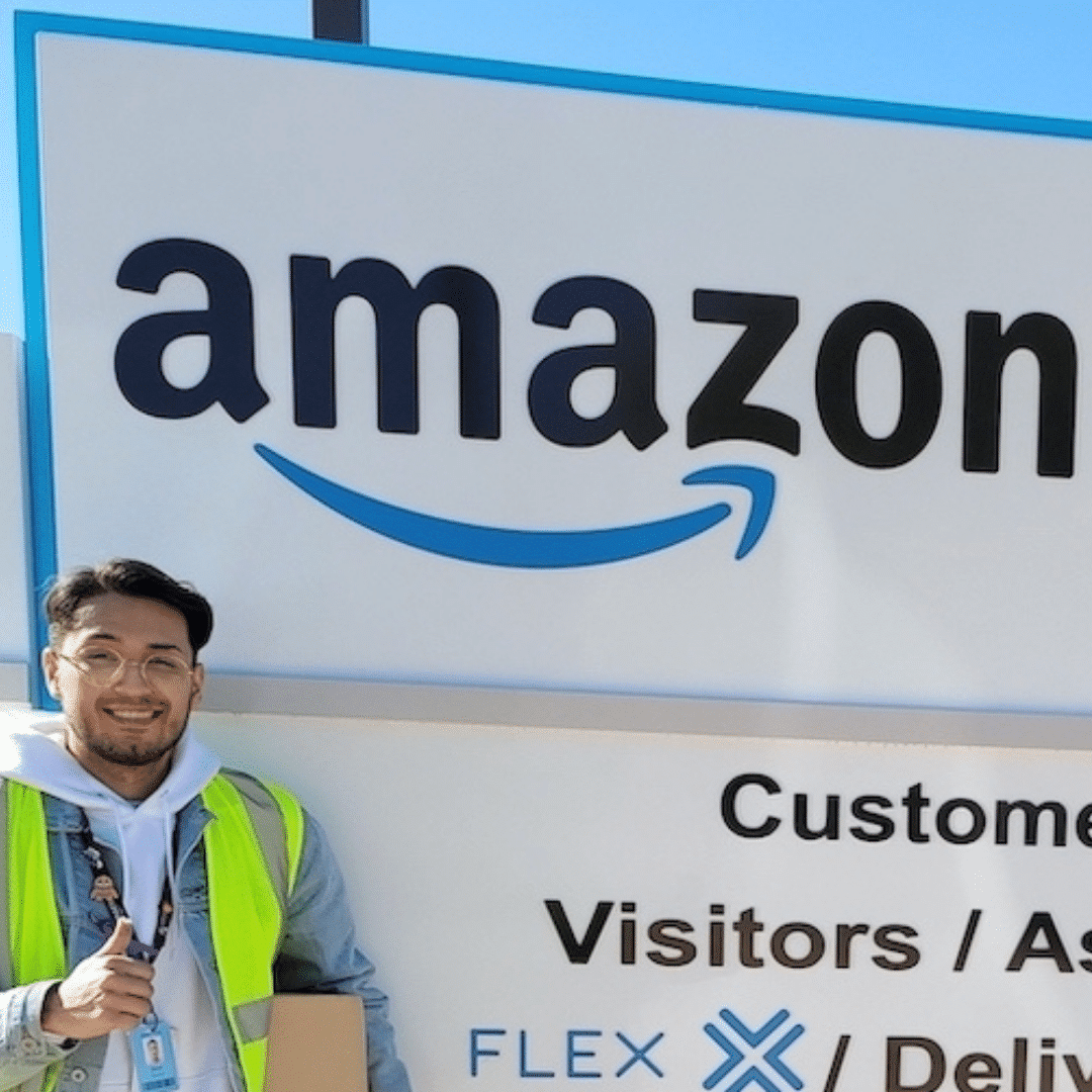 A man in front of Amazon sign