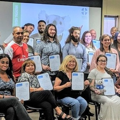 Mental Health First Aid students with their certificates